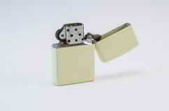 Metal lighter on a white background. Metal yellow lighter on a white background Royalty Free Stock Images