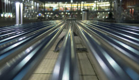 Metal lines. In the night shiny metal lines blurred background stock photos