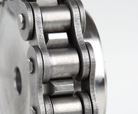 Metal Link Chain And Cogwheel Royalty Free Stock Images