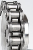 Metal link chain and cogwheel. Close up of metal link chain and cogwheel Stock Photos