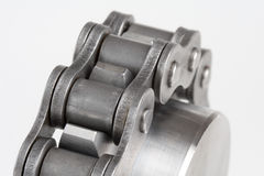 Metal link chain and cogwheel Royalty Free Stock Photo