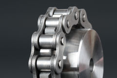 Metal link chain and cogwheel Royalty Free Stock Photos