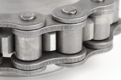 Metal link chain and cogwheel Stock Photo