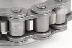 Metal link chain and cogwheel Stock Photo