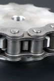 Metal link chain and cogwheel Stock Photos