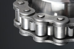 Metal link chain and cogwheel Royalty Free Stock Photography