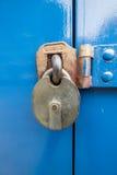 Metal Lock on a blue door Stock Photography
