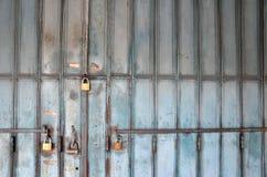 Metal lock on a blue door Stock Images