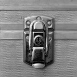 Metal Lock and Clasp Macro. Steel lock, hasp and clasp on an aluminum dimpled art deco style metal case. High resolution film black and white image Stock Images