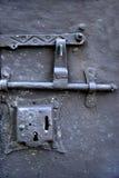 Metal lock on concete door royalty free stock photography