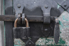 Metal lock on door into the ancient trinity christian ortodox church Royalty Free Stock Images