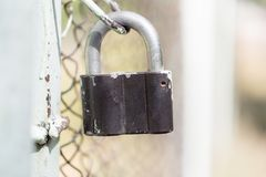 Metal lock on the fence Royalty Free Stock Photo