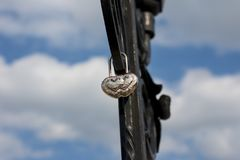 Metal lock in the form of a silver heart. stock image