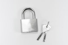 Metal lock and key on white background Stock Photo