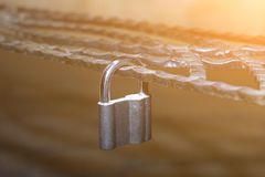 Metal lock, latched on a metal decorative forged lattice. stock image