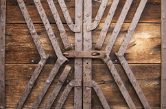 Metal lock and reinforcement on wood gate Stock Photo