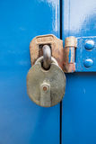 Metal Lock. A rusted metal lock in front of a blue door Stock Photos