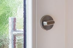 A metal lock on white wooden door. Close up Stock Image