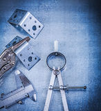 Metal locking pliers with jaws trammel caliper drilled angle bar Stock Photo