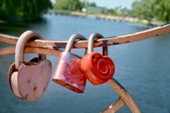 Metal locks on the iron fence of the bridge as a symbol of eternal love stock photos