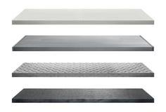 Metal los estantes hechos del acero aislado en el fondo blanco Imagen de archivo libre de regalías