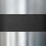 Metal los paneles sobre el ejemplo plástico negro del fondo 3d imagenes de archivo