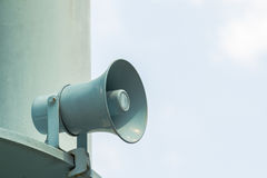 Metal loudspeakers on building for information. Stock Photography
