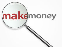 Metal lupe over make money text Royalty Free Stock Image