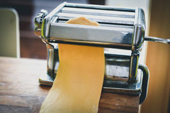 Metal machine for making pasta and fresh dough for lasagna Stock Image