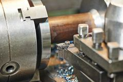 Metal machining by turning on lathe Royalty Free Stock Photo