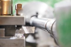 Metal machining by turning on lathe Royalty Free Stock Photos