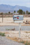 Metal mailbox in the desert Stock Photography