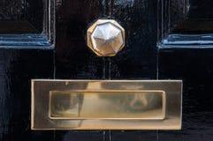 Metal mailbox and door knob Stock Photography