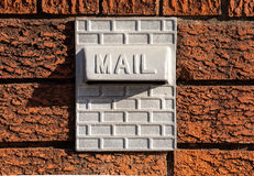 Metal Mailbox Inset into Red Textured Brick Wall Stock Photos