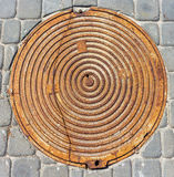 Metal manhole cover close-up royalty free stock photography