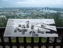 Metal map of Kiev attractions on the background of the city panorama of Kiev royalty free stock photography