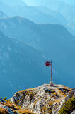 Metal mark at a mountain top in the alp. Stock Images