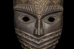 The metal mask isolated on black Stock Photo