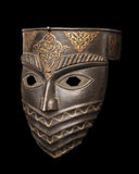 The metal mask isolated on black Stock Images