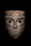 The metal mask isolated on black Royalty Free Stock Photography