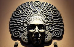 Metal mask on wall Stock Images