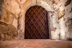 Metal massive door in a stone cave Royalty Free Stock Photos