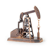 Metal mechanical miniature oil derrick isolated. On white background royalty free stock photos