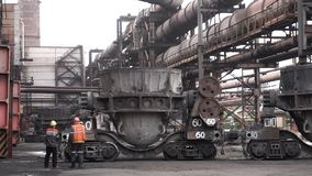 Metal melting vats being transported on big carts to the metal melting shop, heavy industry concept. Stock footage.Two. Metal melting vats being transported on stock image