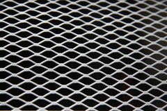 Metal Mesh. A Mesh of Steel. A mesh of metal. A lattice work of steel. A pattern Stock Photography