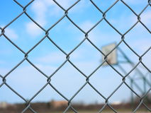 Metal mesh with blur basketball court background Stock Photography