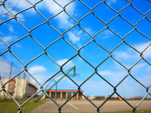 Metal mesh with blur basketball court background Royalty Free Stock Photo