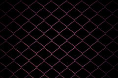 Metal Mesh Fence on black background. Royalty Free Stock Image