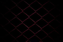 Metal Mesh Fence on black background. Royalty Free Stock Photography