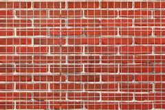 Metal Mesh In Front of Brick Wall Royalty Free Stock Photography
